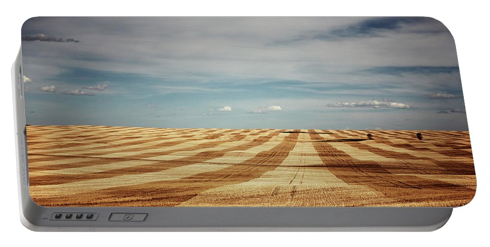 Agriculture Portable Battery Charger featuring the photograph A Pattern Of Stripes Across A Farmers by Todd Korol