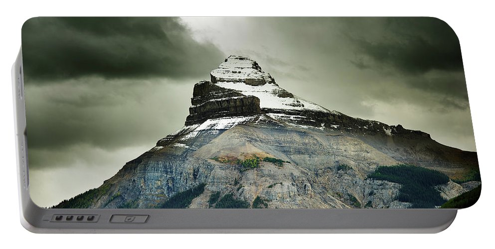 Alberta Portable Battery Charger featuring the photograph A Peak Of A Mountain Top In The Rocky by Todd Korol