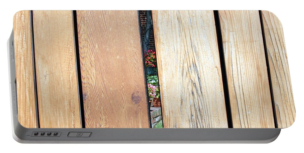 Fence Portable Battery Charger featuring the photograph A Peek Through Wood by Cora Wandel