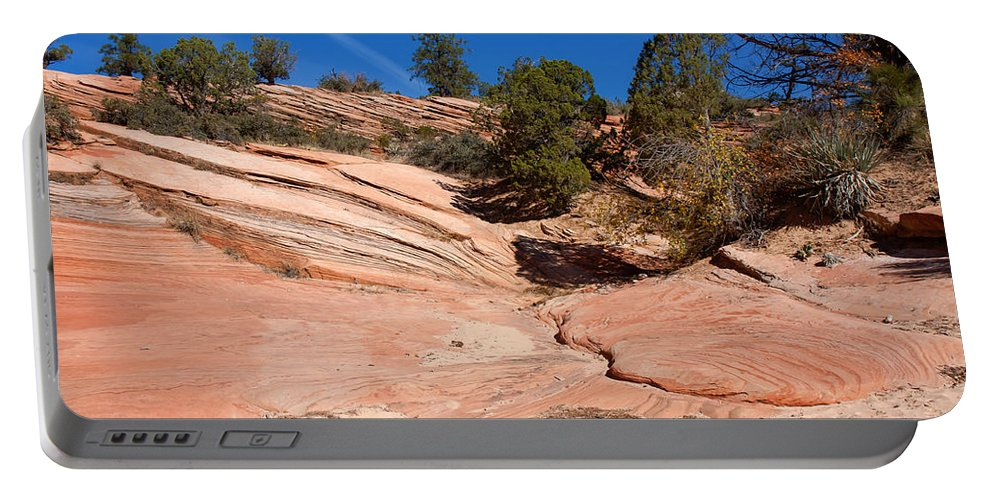 Landscape Portable Battery Charger featuring the photograph A Pool Of Rock by John M Bailey