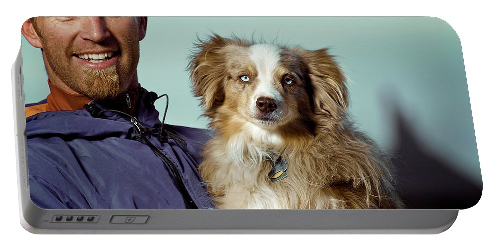 Adult Portable Battery Charger featuring the photograph A Portrait Of A Man And A Dog by Celin Serbo