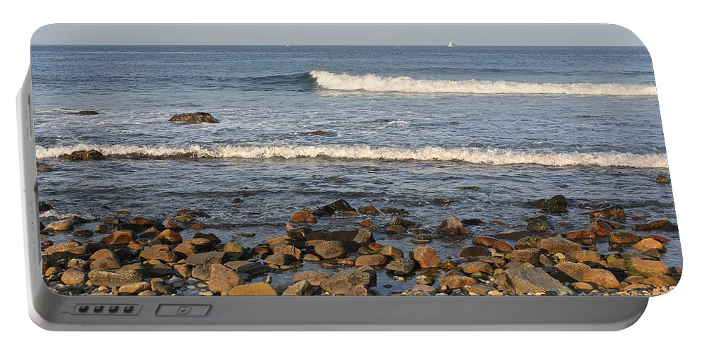 Rocky Portable Battery Charger featuring the photograph A Rocky Beach by Christy Gendalia