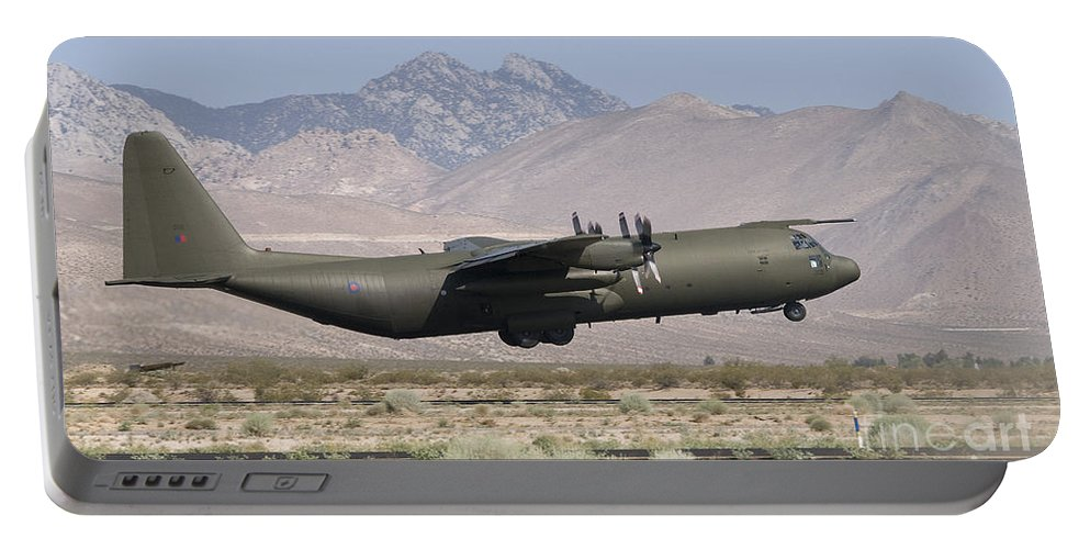 C130k Portable Battery Charger featuring the photograph A Royal Air Force C130k Hercules by Paul Fearn
