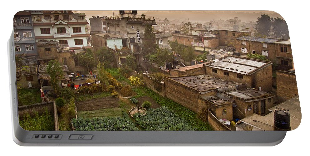Agriculture Portable Battery Charger featuring the photograph A Skyline View Of Roof Tops by Whit Richardson
