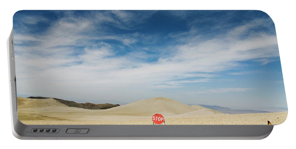 Barren Portable Battery Charger featuring the photograph A Stop Sign In The Middle Of Nowhere by Keri Oberly