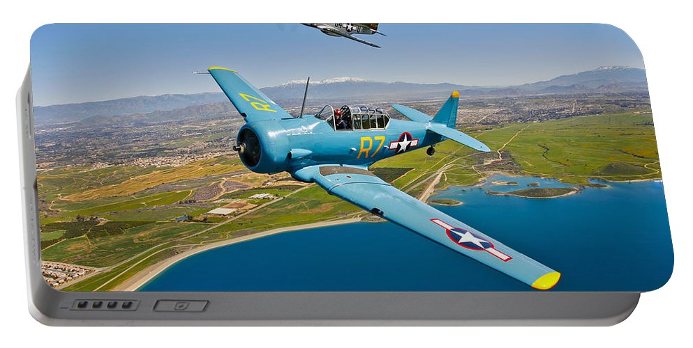 Horizontal Portable Battery Charger featuring the photograph A T-6 Texan And P-51d Mustang In Flight by Scott Germain