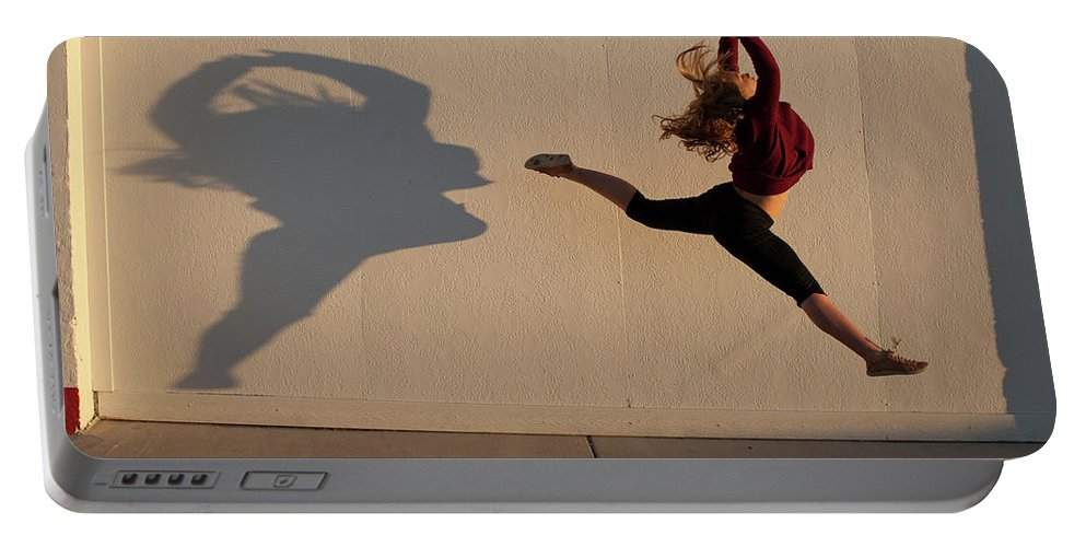 Blonde Hair Portable Battery Charger featuring the photograph A Teenage Girl Playing With Her Shadow by Woods Wheatcroft