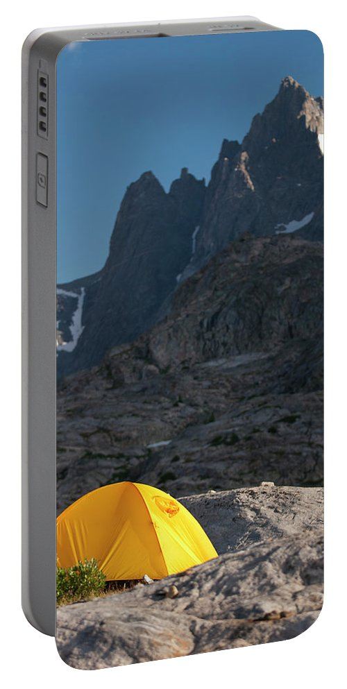 Adventure Portable Battery Charger featuring the photograph A Tent Is Dwarfed By The High Peaks by Jeff Diener