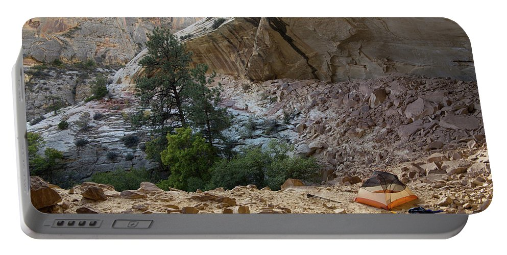 Adventure Portable Battery Charger featuring the photograph A Tent Pitched In A Large Alcove by Whit Richardson