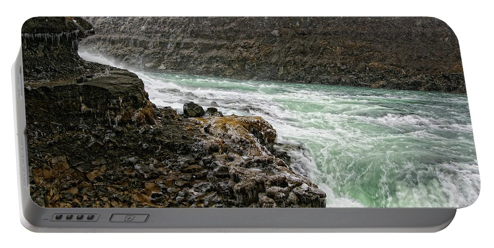 Gullfoss Waterfall Portable Battery Charger featuring the photograph A Tourist Takes A Photo At Gullfoss by Marc Pagani