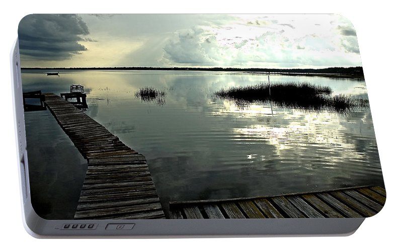 Seascape Portable Battery Charger featuring the photograph A Walk Into The Closing Day by Norman Johnson