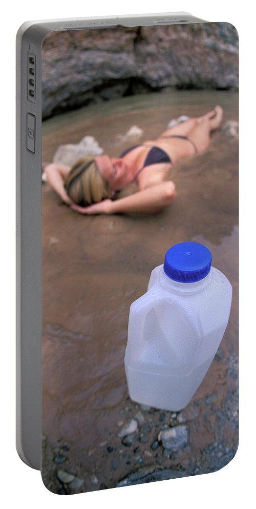 Adult Portable Battery Charger featuring the photograph A Water Jug Near A Woman Soaking by Corey Rich