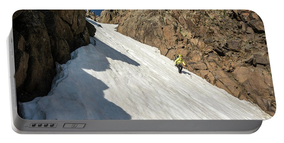 Low Angle View Portable Battery Charger featuring the photograph A Woman Descending A Snow Slope While by Kennan Harvey