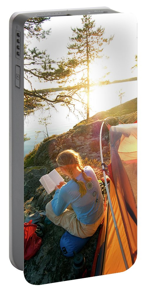 Backlit Portable Battery Charger featuring the photograph A Woman Is Resting In A Tent On One by Lars Schneider