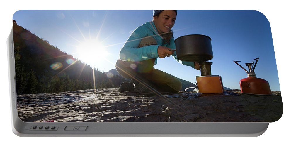 Adventure Portable Battery Charger featuring the photograph A Woman Making Coffee With Portable by Woods Wheatcroft