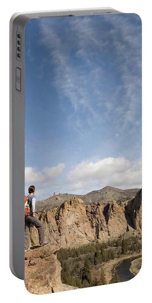25-29 Years Portable Battery Charger featuring the photograph A Woman With A Day Pack Overlooking by Jordan Siemens
