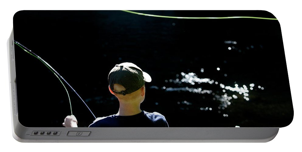10-11 Years Portable Battery Charger featuring the photograph A Young Boy Fly Fishes At Gunpowder by Dennis Drenner