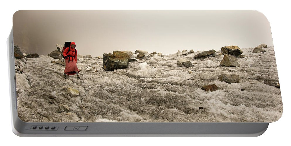 Adventure Portable Battery Charger featuring the photograph A Young Woman Treks Down From Cho La by Mark Fisher