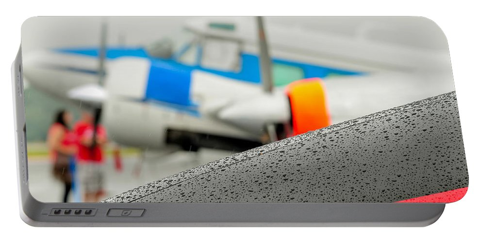 Abstract Portable Battery Charger featuring the photograph Abstract View Of Airshow During A Rain Storm by Alex Grichenko