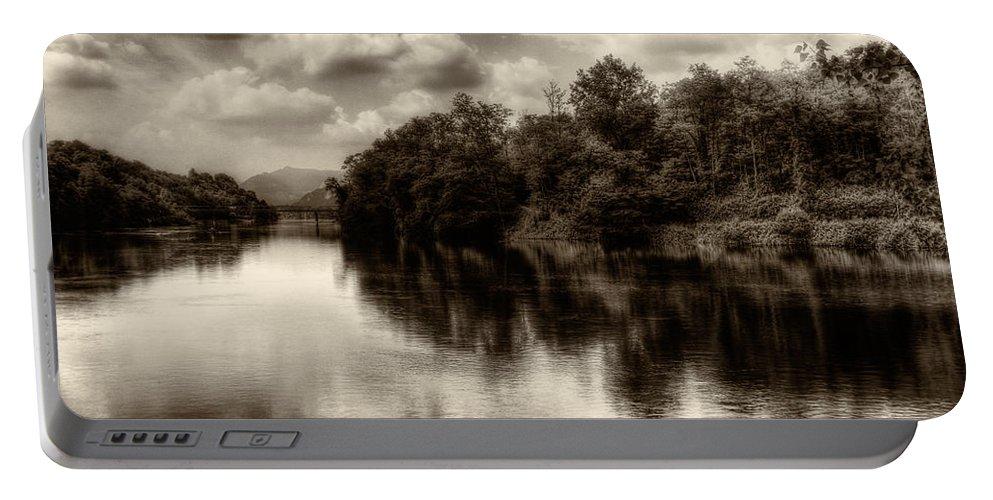 Adda Portable Battery Charger featuring the photograph Adda River 2 by Roberto Pagani
