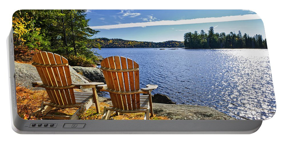 Chairs Portable Battery Charger featuring the photograph Adirondack Chairs At Lake Shore by Elena Elisseeva