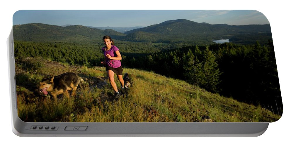 35-39 Years Portable Battery Charger featuring the photograph Adult Woman Trail Running by Woods Wheatcroft