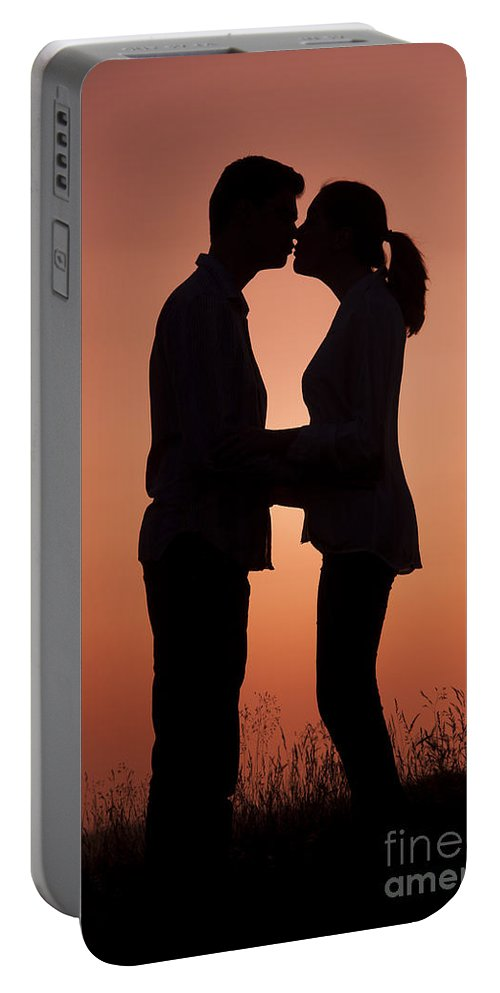 Couple Portable Battery Charger featuring the photograph Affectionate Couple At Sunset In Profile by Lee Avison