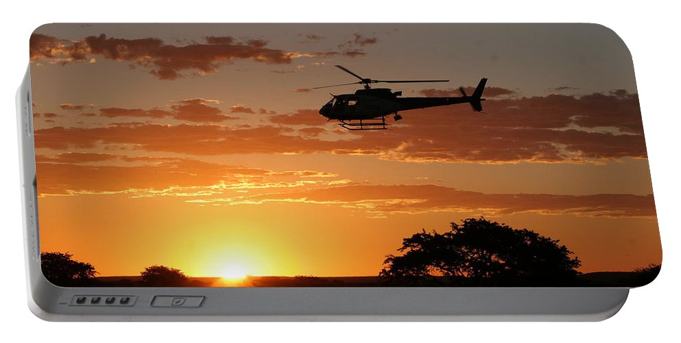 Eurocopter As350 B3 Portable Battery Charger featuring the photograph African Sunset II by Paul Job