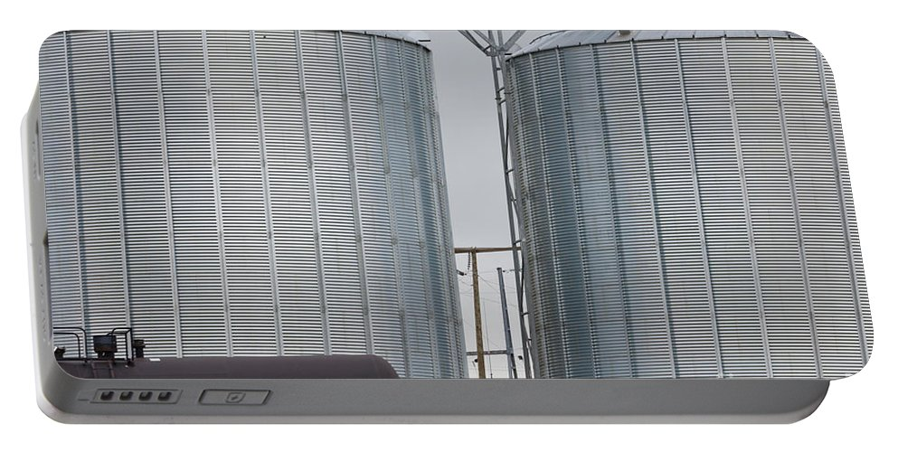 Agribusiness Portable Battery Charger featuring the photograph Agricultural Grain Silos Exterior Railway Wagon by Stephan Pietzko