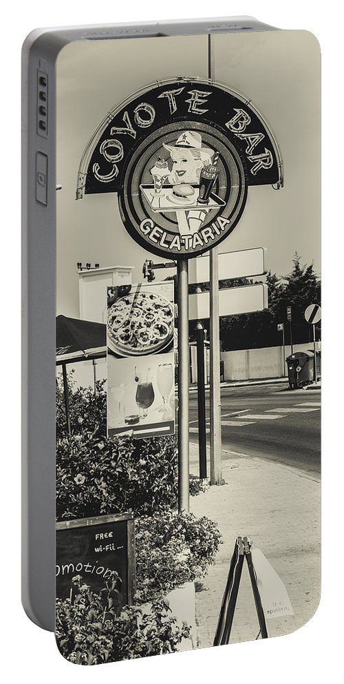 Street Portable Battery Charger featuring the photograph Albufeira Street Series - Coyote Bar I by Marco Oliveira