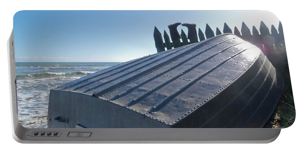 Aluminum Portable Battery Charger featuring the photograph Aluminum Fishing Boat And Boots Drying On Fence by Stephan Pietzko