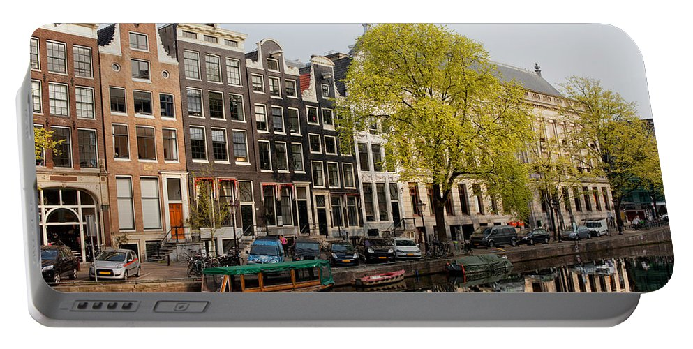 Amsterdam Portable Battery Charger featuring the photograph Amsterdam Houses Along The Singel Canal by Artur Bogacki