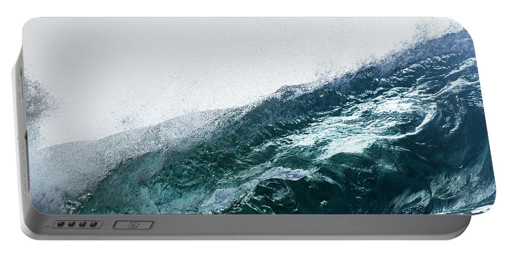 Wave Portable Battery Charger featuring the photograph An Empty Wave Breaks Over A Shallow Reef by Sergio Villalba