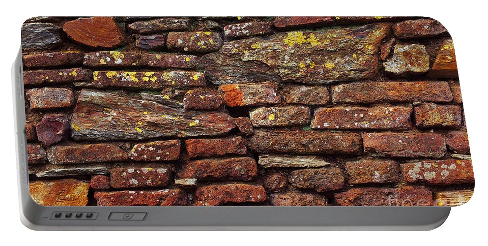 Aged Portable Battery Charger featuring the photograph Ancient Wall by Carlos Caetano