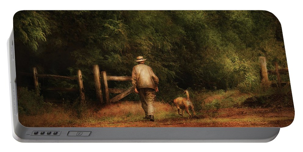 Savad Portable Battery Charger featuring the photograph Animal - Dog - A Man And His Best Friend by Mike Savad