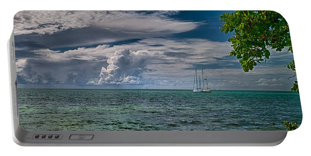 Clouds Portable Battery Charger featuring the photograph Approaching Storm At Whale Harbor by Robert Swinson
