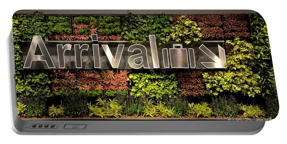 Arrival Portable Battery Charger featuring the photograph Arrival Sign Arrow And Flowers At Singapore Changi Airport by Imran Ahmed