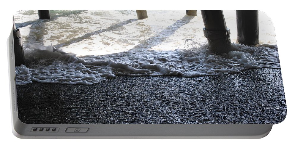 Ocean Portable Battery Charger featuring the photograph Under The Boardwalk by Charlotte Stevenson