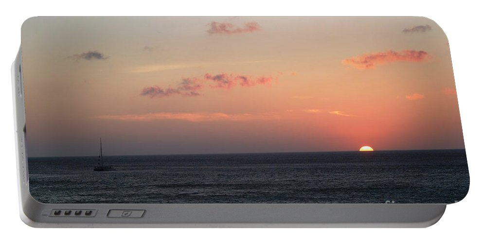 Sunset Portable Battery Charger featuring the photograph Aruba Sunset by Living Color Photography Lorraine Lynch