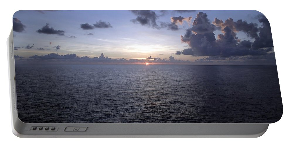 Sea Portable Battery Charger featuring the photograph At Sea -- A Sunrise Begins by Cora Wandel