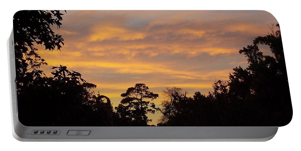 Louisiana Portable Battery Charger featuring the photograph At The End Of The Day by John Glass