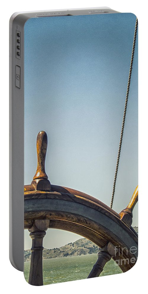 Wheel Portable Battery Charger featuring the photograph At The Helm by Margie Hurwich