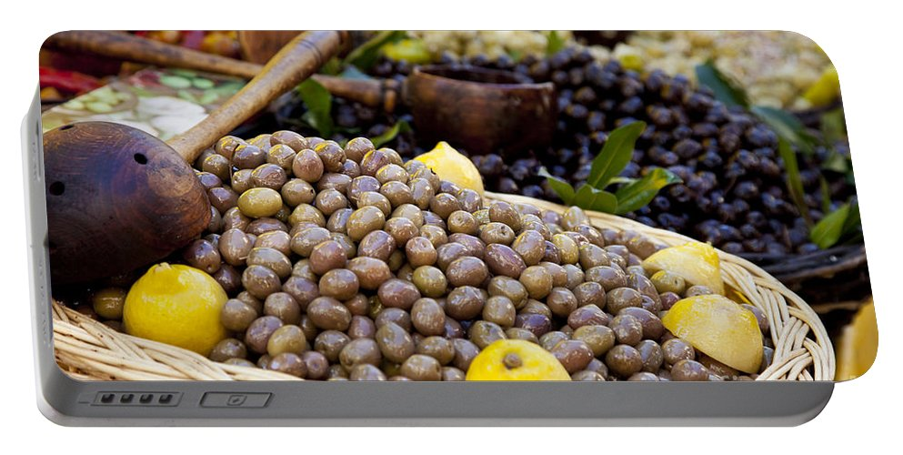 Olive Portable Battery Charger featuring the photograph At The Market by Brian Jannsen