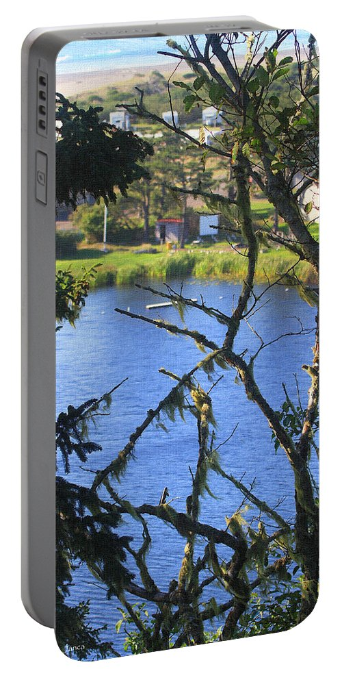 At The Oregon Coast Portable Battery Charger featuring the photograph At The Oregon Coast by Tom Janca