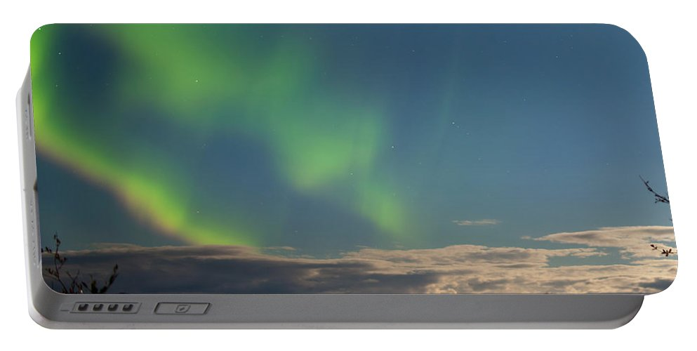 Astronomy Portable Battery Charger featuring the photograph Aurora Borealis Moon-lit Clouds Over Lake Laberge by Stephan Pietzko