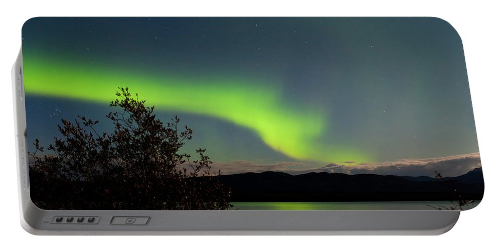 Astronomy Portable Battery Charger featuring the photograph Aurora Borealis Reflected On Lake Laberge Yukon by Stephan Pietzko