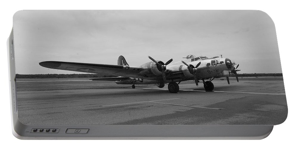 Flying Fortress Portable Battery Charger featuring the photograph B17 Bomber Parked by Thomas Woolworth
