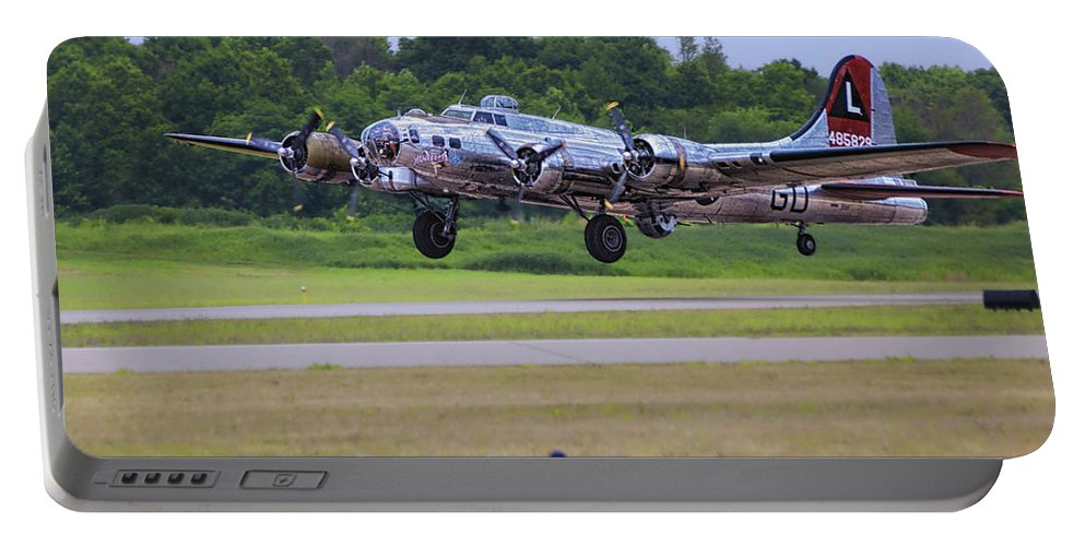 Flying Fortress Portable Battery Charger featuring the photograph B17 Bomber Taking Off by Thomas Woolworth