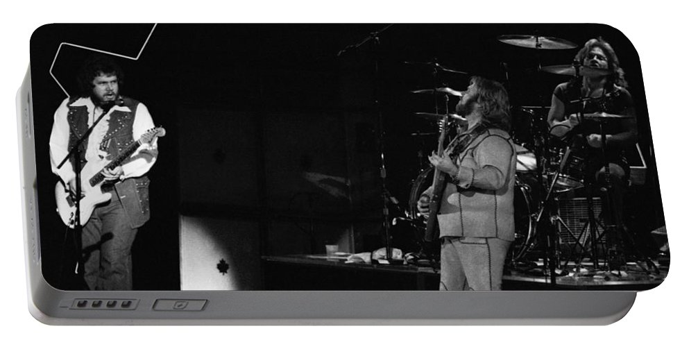 Bachman-turner Overdrive Portable Battery Charger featuring the photograph Bachman-turner Overdrive In Spokane In 1976 by Ben Upham
