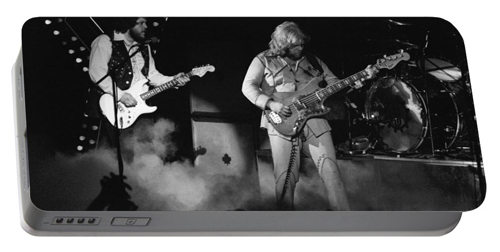 Bachman-turner Overdrive Portable Battery Charger featuring the photograph Bachman-turner Overdrive Smokin In Spokane 1976 by Ben Upham